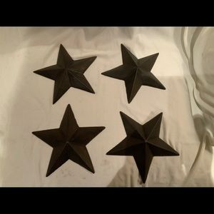 Set of four cast iron star wall hangings